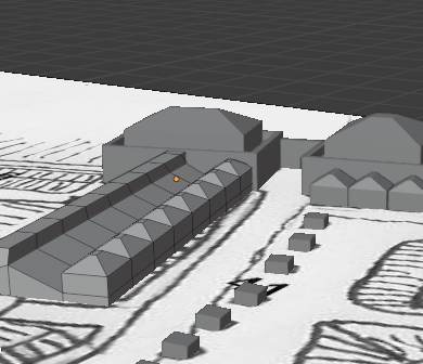 A 3D image of two towers joined by a gate, and a row of houses with a wall behind.  The map from which they are projected is visible on the ground plane.